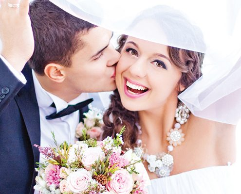 Young couple with Invisalign aligners getting married