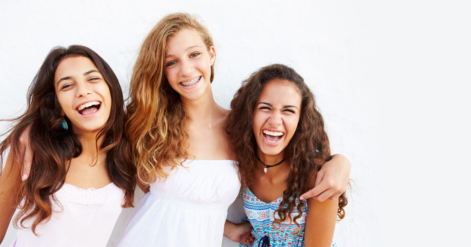 Teenage with braces learns her friends both have Invisalign aligners