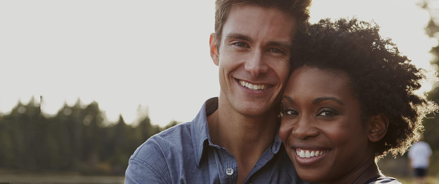 Couple getting treated with Invisalign in Asheville, NC