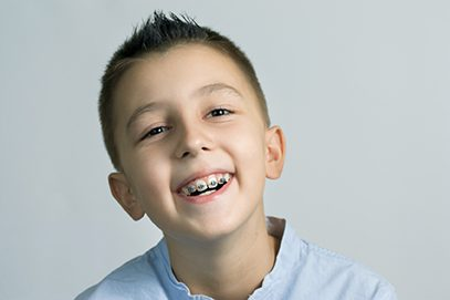 Boy with braces smiling in Asheville, NC