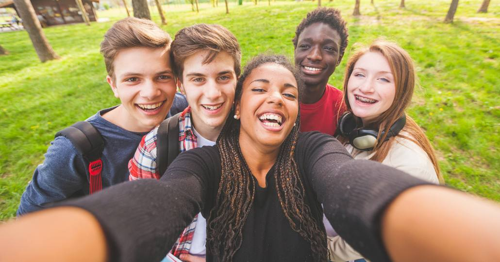 Teenage with braces brings friends to an event at BRO in Asheville, NC