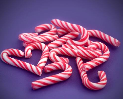 Candy canes collected by girl with braces during the holidays