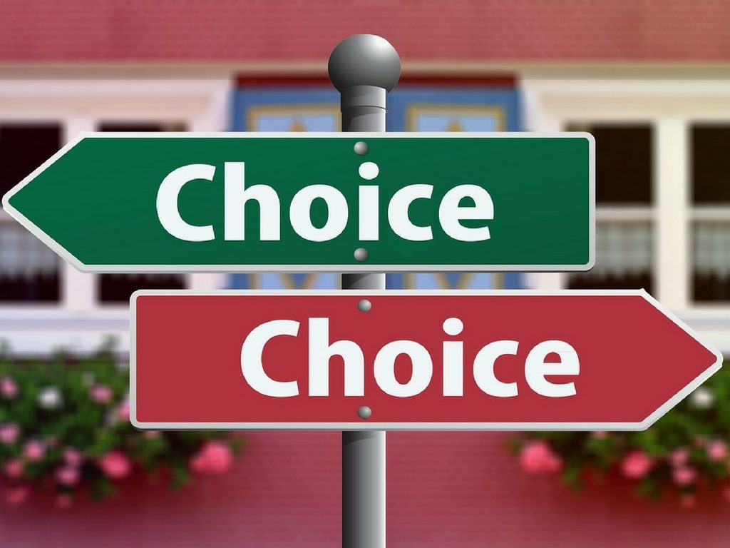 Sign represents decision between Invisalign and other orthodontic treatment