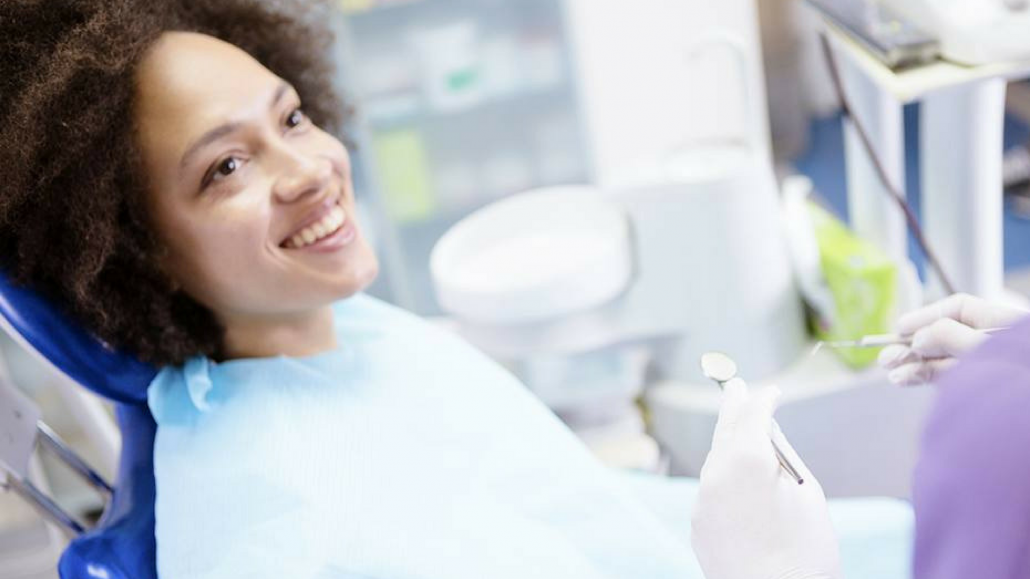Woman comes in for oral surgery consultation in Asheville, NC