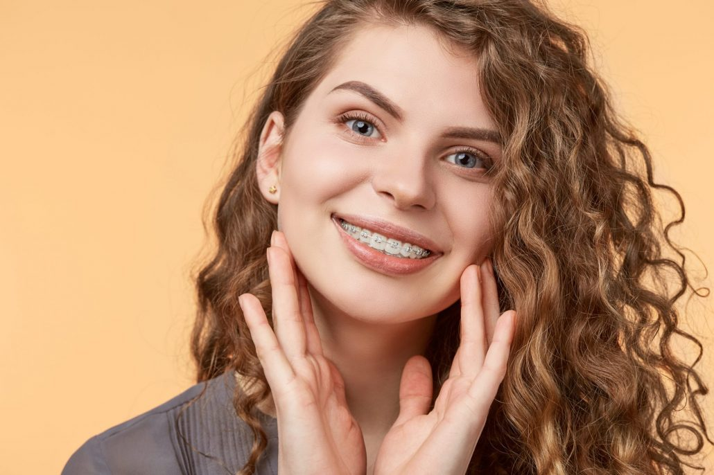 Woman gets ceramic braces from orthodontist in Asheville