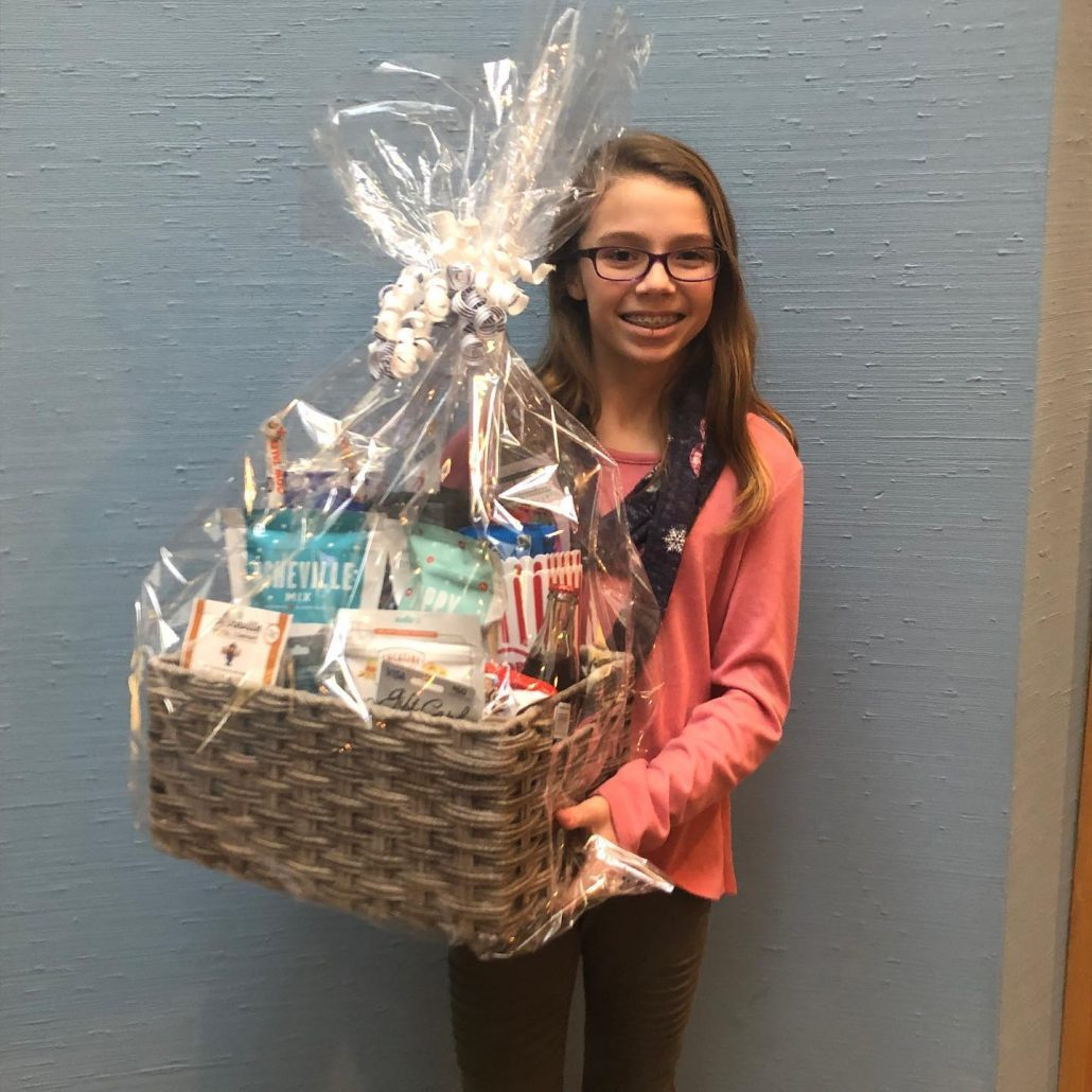 Girl in Asheville who won Movie Night Contest from Blue Ridge Orthodontics