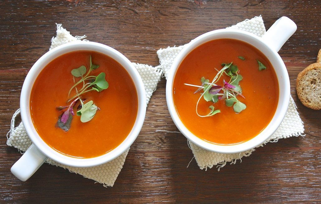 Person picks tomato soup to eat after oral surgery