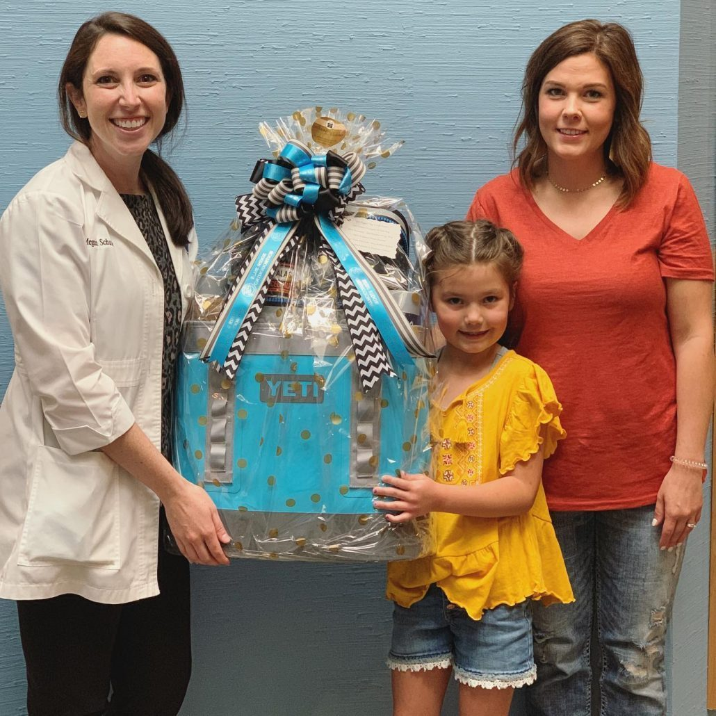 Dr. Schuler gives family Yeti gift basket in Asheville, NC