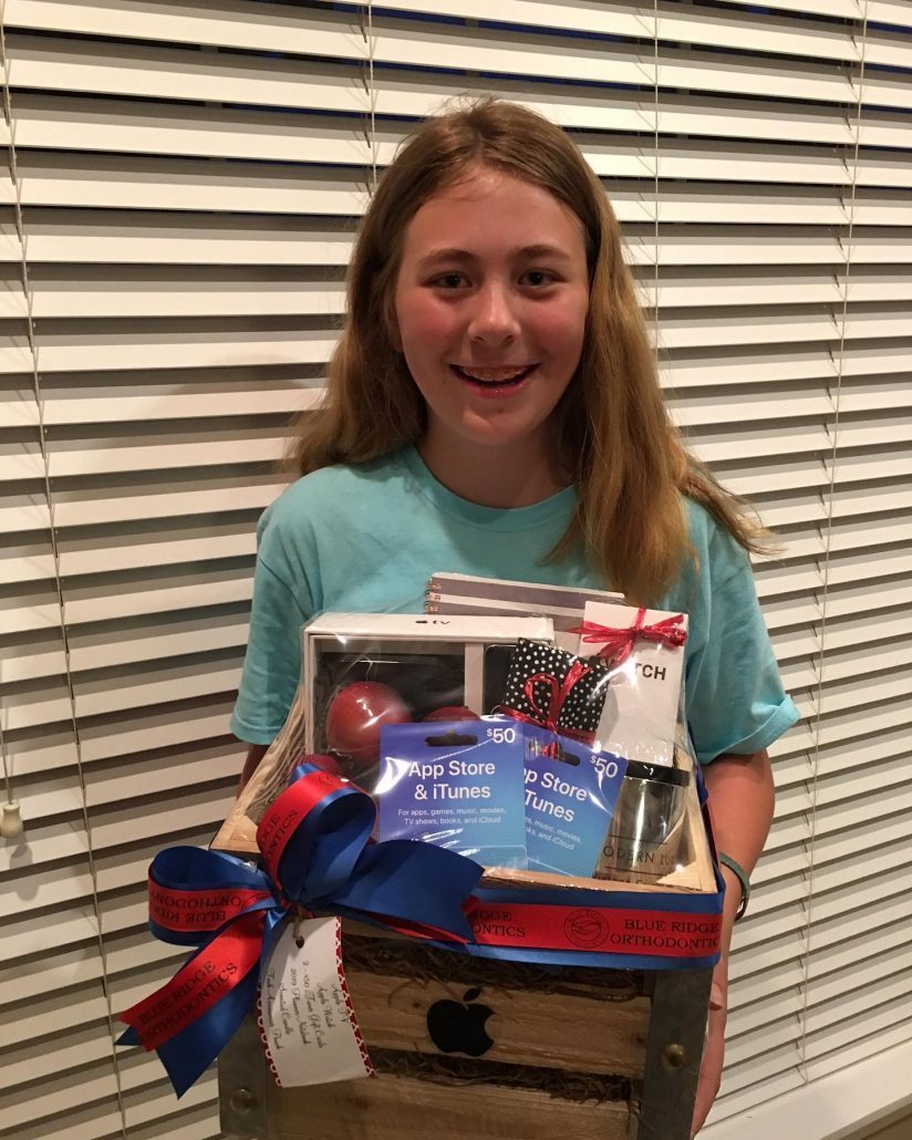 Young girl wins Apple gift basket in Asheville