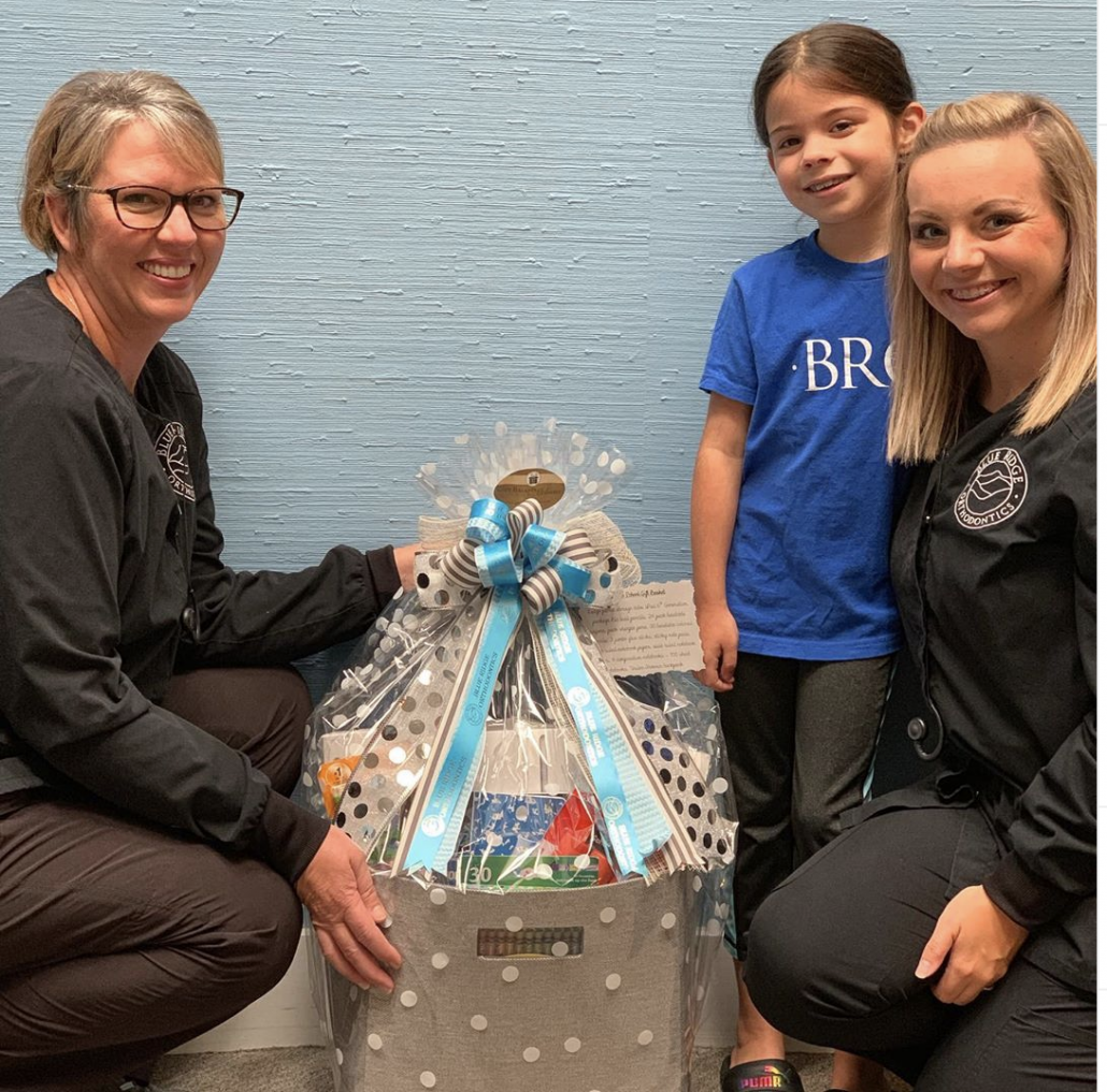 Young girl who won back to school gift basket from BRO